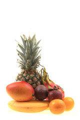 pineapple mango orange banana and dragon fruit