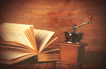 Coffee gringer and ropened book