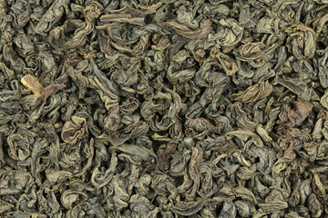 some dried black tea leaves abstract background