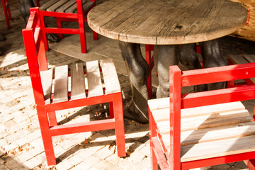 red designer chairs and a table in the form of human feet