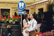 couple walk in old town lviv,kissing,loving