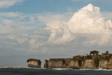 giant cumulus clouds above cliffs at Cape Foulwind