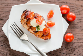 Grilled chicken steak with mozzarella and cherry tomatoes