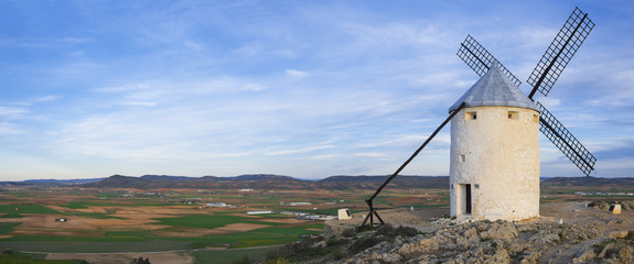 Blue sky and windmills in the background, Castilla-La Mancha.