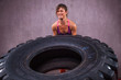 Fit young Woman Doing  Exercise With Tire - 81195423