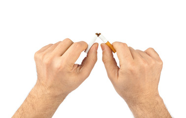 Broken cigarette in hands
