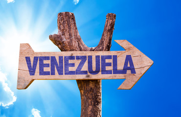 Venezuela wooden sign with sky background
