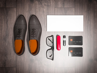 Every day carry man items collection: glasses, knife, shoes .