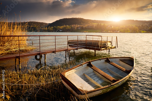 Boat on lake near pier © Creaturart