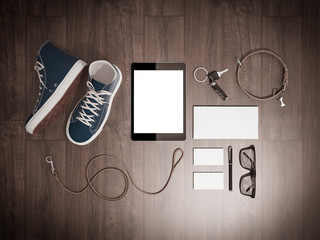 Every day carry man items collection: glasses, leash, sneakers.
