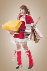 Asian Christmas girl hold shopping bags