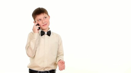 School boy using mobile phone and calls somebody on white
