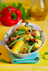 Warm salad from potato and mushrooms with arugula.