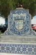 Leinwanddruck Bild - This fountain made of tiles is typically portuguese.