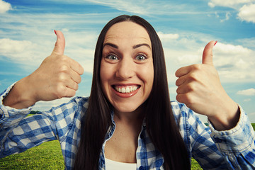 happy woman with thumbs up
