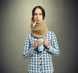 woman in scarf have a flu