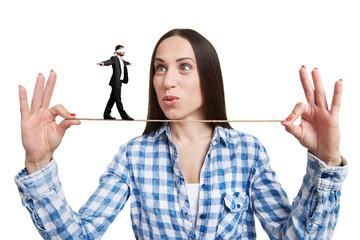 woman looking at small man