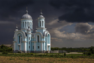 The Church on the background of a stormy sky