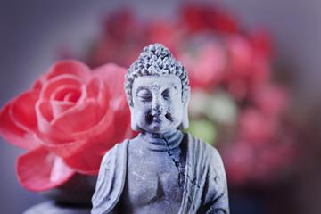 detail of stone sitting buddha