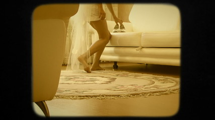 Bride Taking Wedding Shoes Off The Sofa. Retro Style