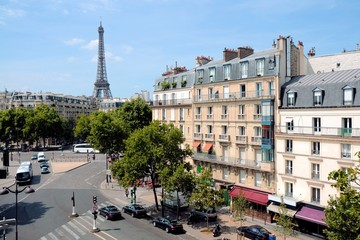 View over the grand streets of Paris, France with Eiffel Tower