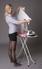 Woman inspecting a shirt she is ironing