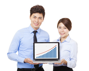 happy business man and woman showing laptop with graph