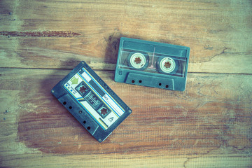 Old cassette tape on wooden board