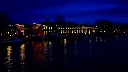 Amsterdam in the Netherlands by night at the river Amstel