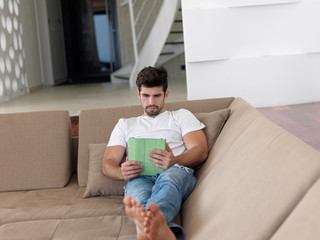 man using tablet computer from home