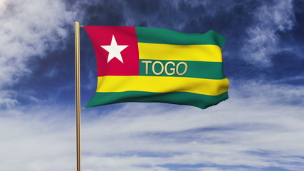 Togo flag with title waving in the wind. Looping sun rises style