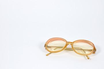 Red vintage eye-glasses on background.