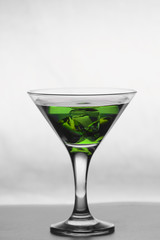 Martini glass on wooden table