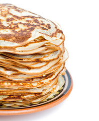 stack of crepes on a plate isolated on white