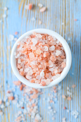 himalayan pink salt on wooden surface