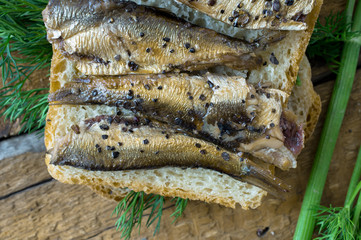 Sandwich with sardines for the background