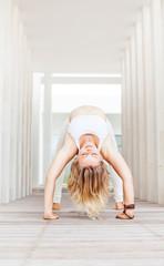 woman doing yoga asana in a spacious studio