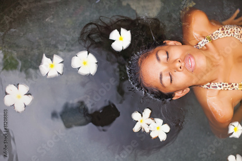 canvas print picture Beautiful exotic woman having bath in a luxury spa salon