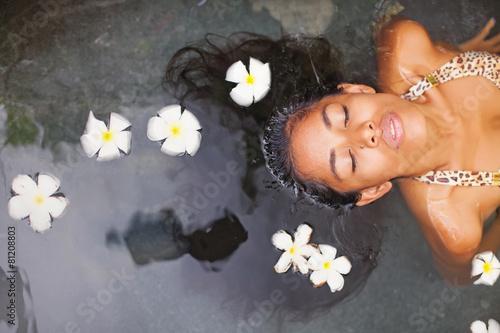 Beautiful exotic woman having bath in a luxury spa salon - 81208803