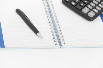 Business concept with calculator, pen and notebook