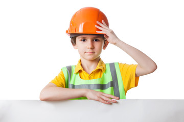 Kid in work clothes stands with billboard, isolated on white
