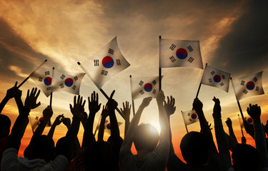 Group of People Waving South Korea Flags Concept