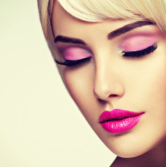 Portrait of  a  Beautiful  woman with  bright pink make-up.