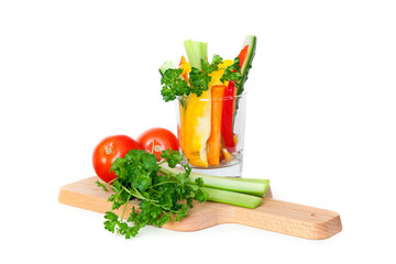 Fresh vegetables on cutting board, isolated on white background