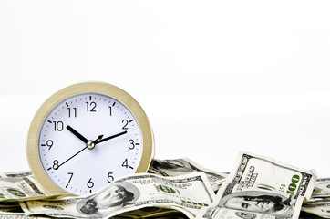 Close-up of clock and money with white background