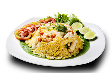 seafood fried rice with tomato and lemon
