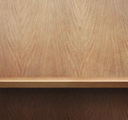 Empty bookshelf or shelf on wooden wall background
