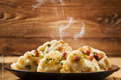 Spoed canvasdoek 2cm dik Restaurant Delicious homemade dumplings with onion and bacon