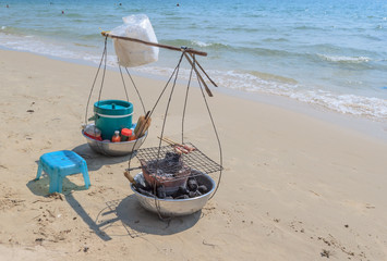 Asian yoke with fried seafood on the sand at beach