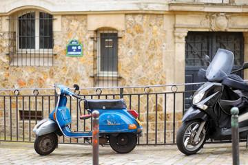 Retro scooter parked on Paris street